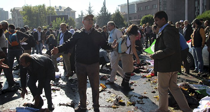 A man reacts after an explosion during a peace march in Ankara, Turkey, October 10, 2015