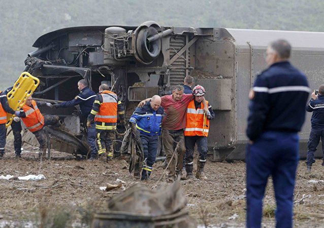 Rescue workers carry a victim from the wreckage of a test TGV train that derailed and crashed in a canal outside Eckwersheim near Strasbourg, eastern France, November 14, 2015