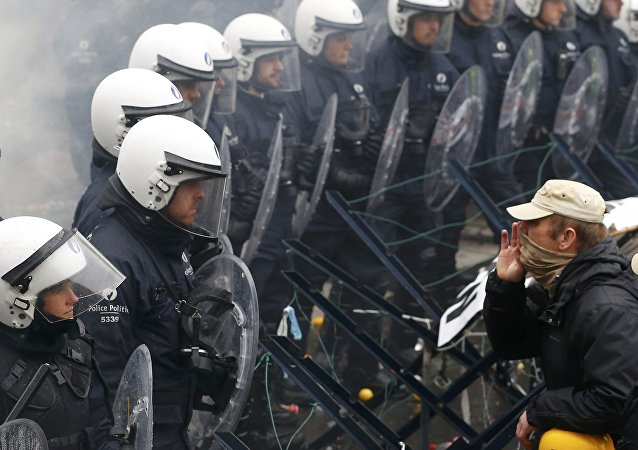 A Belgian soldier shouts at police officers during a protest by soldiers against planned pension reforms in central Brussels, Belgium, November 15, 2016.