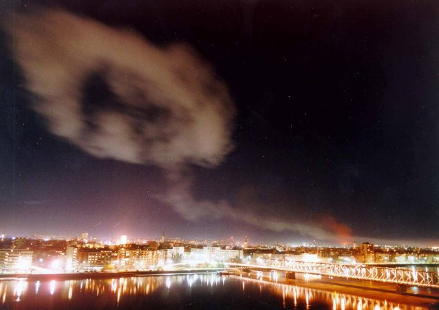 Smoke billows over the northern Yugoslav city of Novi Sad, some 70 kms. north of Belgrade after NATO air raids late Wednesday March 24, 1999.